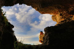 Cave hole sky relaxing man Royalty Free Stock Image