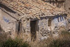 Cave house abandoned. Ancient gateway to a cavin a cave house . The cave houses are typical houses of northern province of Granada (Spain Royalty Free Stock Image