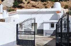 Cave-house painted white lime in Cortes village. Granada, Spain, southern Spain Royalty Free Stock Images