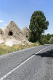 A cave house and road in Cappadocia, Nevhehir, Turkey Royalty Free Stock Photography