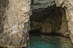 And the end. Cave interior on the shores of Zakynthos island in the ionic sea Royalty Free Stock Images