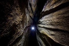 Cave with light at the end. Cave with light from caver at the end Royalty Free Stock Images