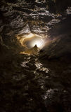 Cave with light and stalagmite Stock Photos