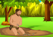 Cave man. Ancient man sitting in the forest to trying to fire the wood Royalty Free Stock Photography
