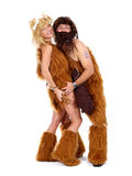 Cave man and cave woman Stock Photos