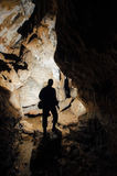 Cave with man silhouette explorer stock photo