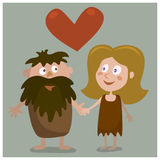 Cave man and woman Stock Images