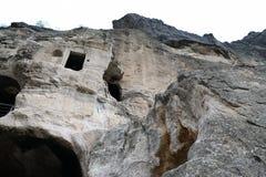 Cave monastery coverd in rock, Vardzia. Georgia Stock Image