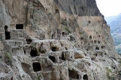 Cave monastery coverd in rock, Vardzia. Georgia Stock Photo