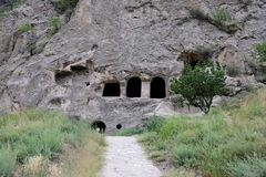 Cave monastery coverd in rock, Vardzia. Georgia Royalty Free Stock Photo