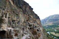 Cave monastery coverd in rock, Vardzia. Georgia Stock Images