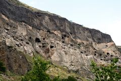 Cave monastery coverd in rock, Vardzia. Georgia Stock Photos