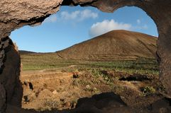 Cave near a volcano in the desert Royalty Free Stock Photography