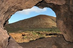 Cave near a volcano in the desert Stock Photos