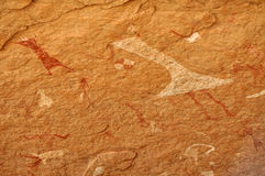 Cave Painting of Dancer. Prehistoric cave painting of a dancer, Tadrart Acacus Mountains, W Sahara, Libya, a UNESCO world heritage site stock photography