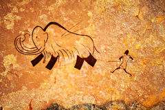 Cave painting of primitive hunt Stock Image