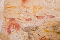 Cave paintings in Argentina. Ancient hunting scene painted in a cave in Patagonia, Southern Argentina Royalty Free Stock Photo