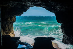 Cave paradise blue sea and sky relaxation paradise on beach tourism Stock Image