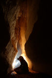 Cave passage with a caver. Taking a break Royalty Free Stock Images