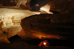 Cave passage with a caver. Exploring the cave stock photo