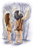 Cave people. Caveman is drawing heart for her lover in a cave Stock Photos