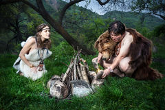 Cave people near bonfire Stock Photography