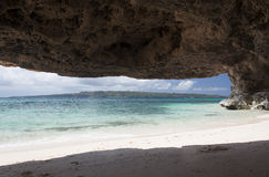 Cave on Puka Shell Beach. Boracay island. On the northern end of the most popular beach destination in the country is an 800 meter stretch of white sand and puka Royalty Free Stock Images