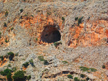 Cave in the red hill Stock Image