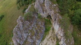 Cave in rock aerial up. HD stock video footage