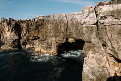 Cave in a rock ashore ocean, Portugal Stock Images