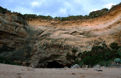 A cave in the rock wall of Loch Ard Gorge Stock Photography