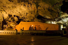 Cave Sanctuary. Lying Buddha statue in Khao Luang cave sanctuary, Petchaburi, Thailand Stock Photo