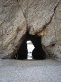 Cave into the sea Stock Images