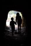 Cave silhouette of children Royalty Free Stock Photos