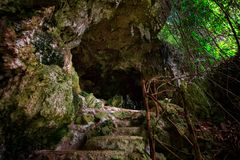 Cave with stalactites in the tropical jungles of the Philippines.  royalty free stock images