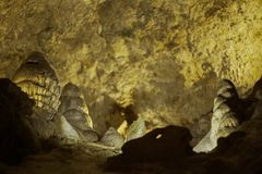 Cave with stalagmites and stalactites below the surface. Cave with stalagmites and stalactites landscape below the surface old stock photos