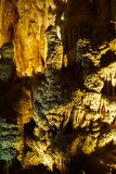 Cave with stalagmites and stalactites below the surface. Cave with stalagmites and stalactites landscape below the surface old royalty free stock photography