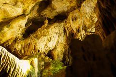 Cave with stalagmites and stalactites below the surface. Cave with stalagmites and stalactites landscape below the surface old stock photo