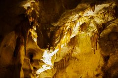 Cave with stalagmites and stalactites below the surface. Cave with stalagmites and stalactites landscape below the surface old stock photography