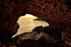 cave and sunset