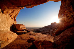 Cave and sunset in the desert mountains. Entrance to cave and the sunset in desert mountains Bektau-Ata, Kazakhstan Royalty Free Stock Photos