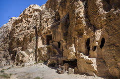 Cave tombs in Nabataean city of the Siq al-Barid in Jordan. It i Royalty Free Stock Image