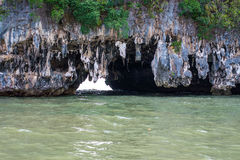 Cave,Tourists kayaking through limestone cliffs in Phang-nga Bay of Thailand. Cave,Tourists kayaking through limestone cliffs in Phang-nga Royalty Free Stock Photography