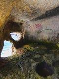 Cave under Sant Nicolau Castle in Ciutadella Stock Photos