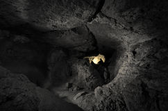 Cave underground with man at entrance Royalty Free Stock Photography