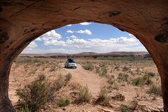 Cave View of Car and Desert. An automobile and desert landscape viewed from a cave in America's beautiful southwestern desert near the San Juan River, Arizona Stock Images