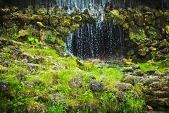 cave and waterfall - beauty in nature, landscapes and environment concept stock photos