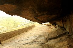 The cave way of jain stone beds of sittanavasal cave temple complex. Sittanavasal is a small hamlet in Pudukkottai district of Tamil Nadu, India. It is known stock photography