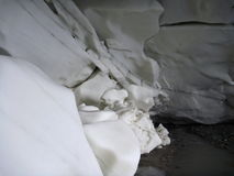 Cave in the white ice of the glacier Royalty Free Stock Photos