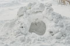 A cave is in a white snowdrift for playing in the yard in winter stock photos